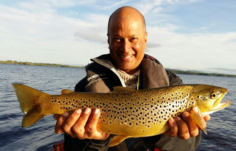 Azim with a 4.75lb Sheelin trout caught on a spent.